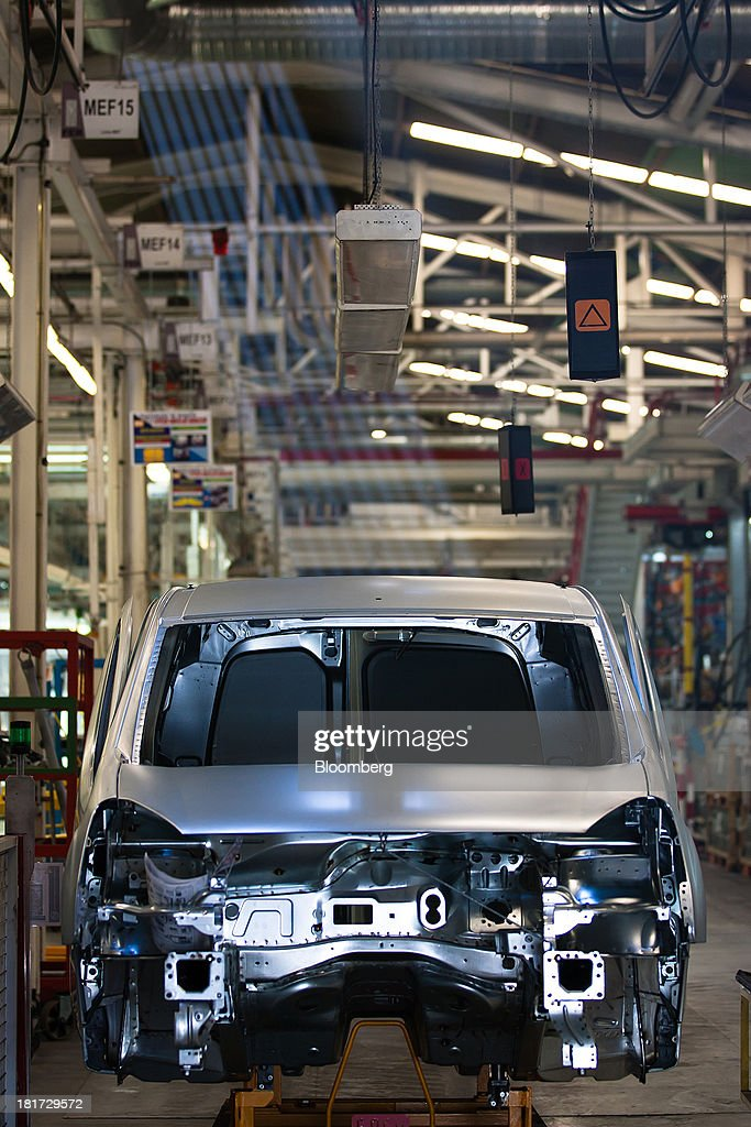 An unpainted body section of a Citroen Berlingo automobile moves along the production line at the PSA Peugeot Citroen plant in Mangualde, Portugal, on Monday, Sept. 23, 2013. Some economists point to falling labor costs across southern Europe as a sign the region may be becoming more attractive as a manufacturing base. Photographer: Mario Proenca/Bloomberg via Getty Images