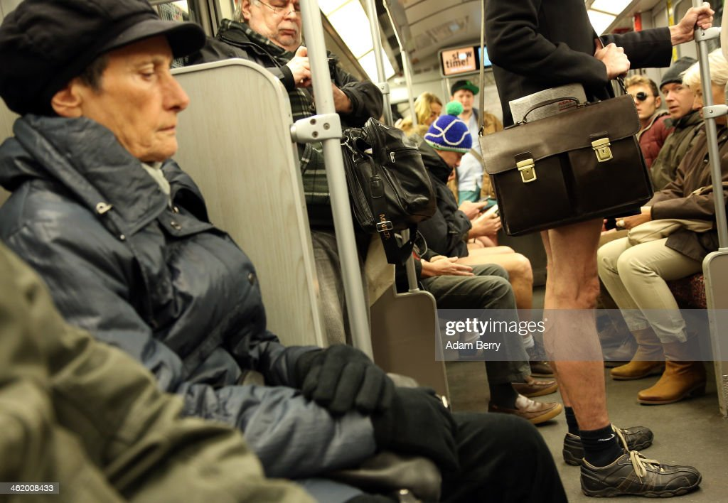 An unsuspecting passenger sits next to a participant of the No Pants Subway Ride on a train on January 12 2014 in Berlin Germany The annual event in...
