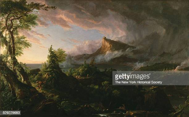 An untamed wilderness landscape depicted at sunrise symbolizing the dawn of civilization 1834 A violent storm sweeps over the mountains and ocean...