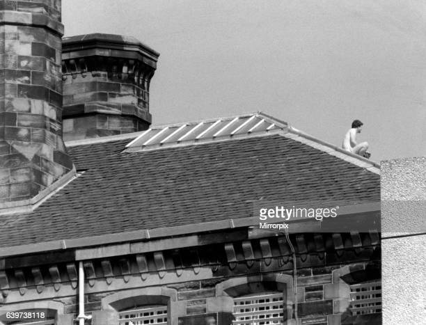 An untried prisoner stripped to his shorts settles down to his rooftop protest at HMP Barlinnie Prison June 1988