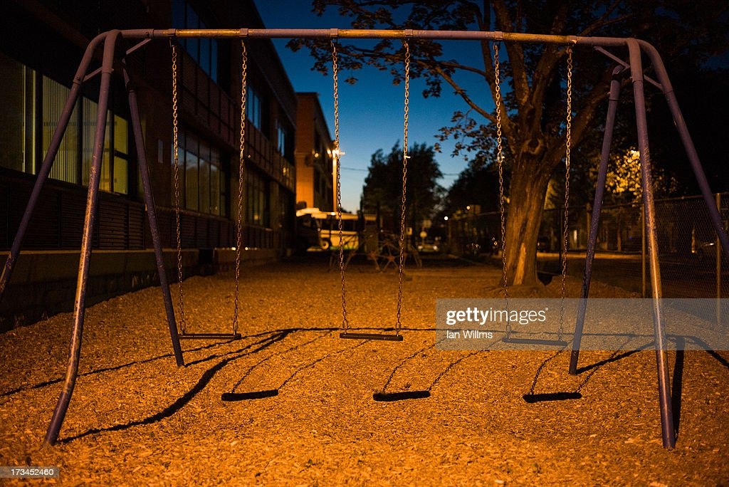 An unused swing set at a local school where police have set up a temporary command centre, on July 13, 2013 in Lac-Megantic, Quebec, Canada. A train derailed and exploded into a massive fire that flattened dozens of buildings in the town's historic district, leaving 60 people dead or missing in the early morning hours of July 6.