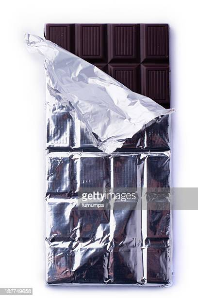 An unwrapped dark chocolate bar
