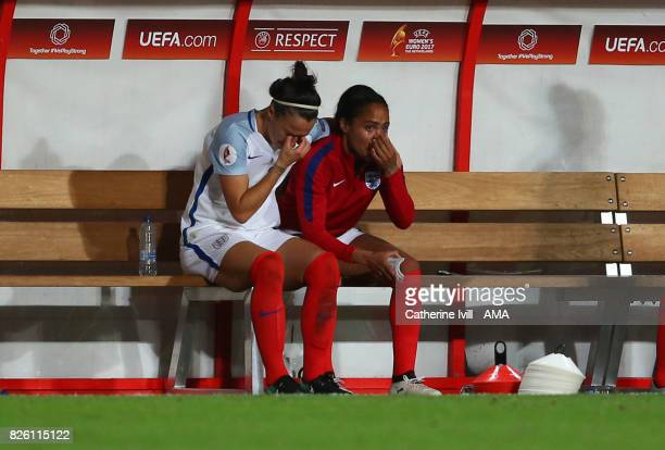 An upset looking Lucy Bronze and Alex Scott of England Women sit on the bench after the UEFA Women's Euro 2017 semi final match between Netherlands...