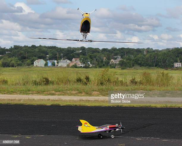 An upside down align trex 700E helicopter flew over Rumney Marsh in Saugus Mass where the 107th Radio Control Flyers met on August 23 2014
