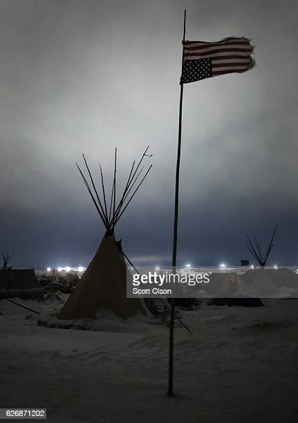 An upside down American flag flies above Oceti Sakowin Camp on the edge of the Standing Rock Sioux Reservation on November 30 2016 outside Cannon...