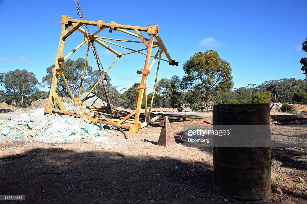 An upturned mine frame lies on the ground at the Phoenix Gold Ltd. Castle Hill gold project in Kunanalling, northwest of Kalgoorlie, Australia, on Tuesday, Aug. 6, 2013. Gold prices will rebound as output remains little changed or declines this year with producers cutting spending and shuttering some costly operations, the World Gold Council said. Photographer: Carla Gottgens/Bloomberg via Getty Images