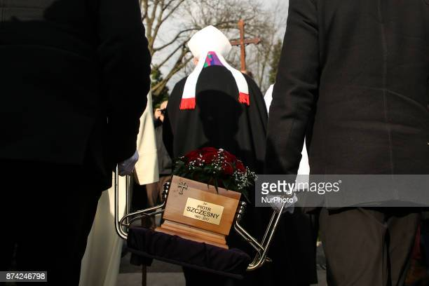 An urn with ashes of Piotr Szczesny is carried out of the Chapel after the funeral mass at Salwator cemetery in Krakow Poland on 14 November 2017...
