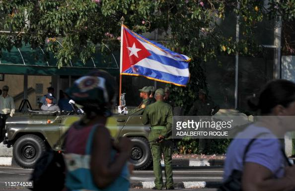 An URSSmade military jeep with a Cuban flag is seen on a street near Revolution Square on April 14 2011 in Havana during a rehersal for the upcoming...