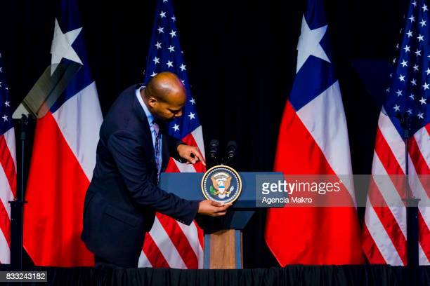 An US Agent accommodates the United States shield on the podium prior to a business dinner between US Vice President Mike Pence and members of the...