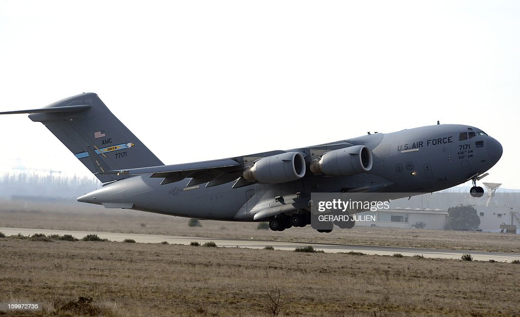 An US Airforce C17 aircraft loaded with French armoured vehicles and soldiers takes off Istres military airport (BA 125) on January 24, 2012, heading toward Mali as part of the 'Serval' operation.