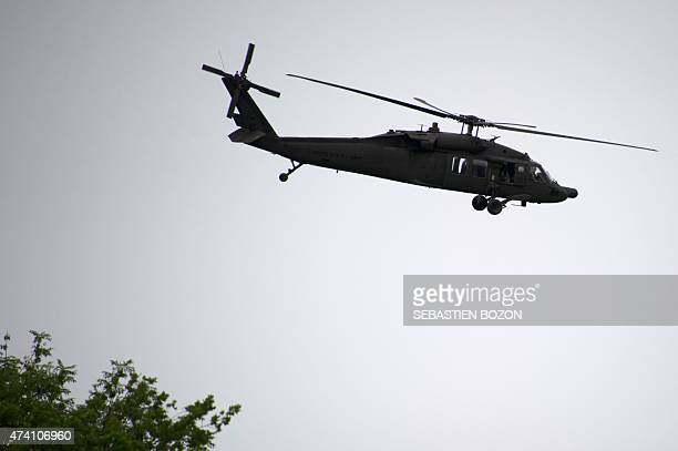 An US Blackhawk helicopter flies during a FrenchUS 'Royal Blackhawk' military exercise with French US Dutch British and Belgian troops on May 20 in...