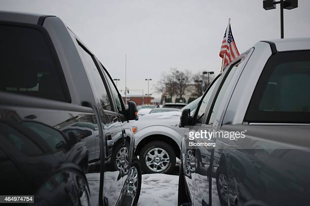 An US flag is seen on a 2014 Ford Motor Co F150 truck displayed for sale at the Oxmoor Ford car dealership in Louisville Kentucky US on Wednesday Feb...