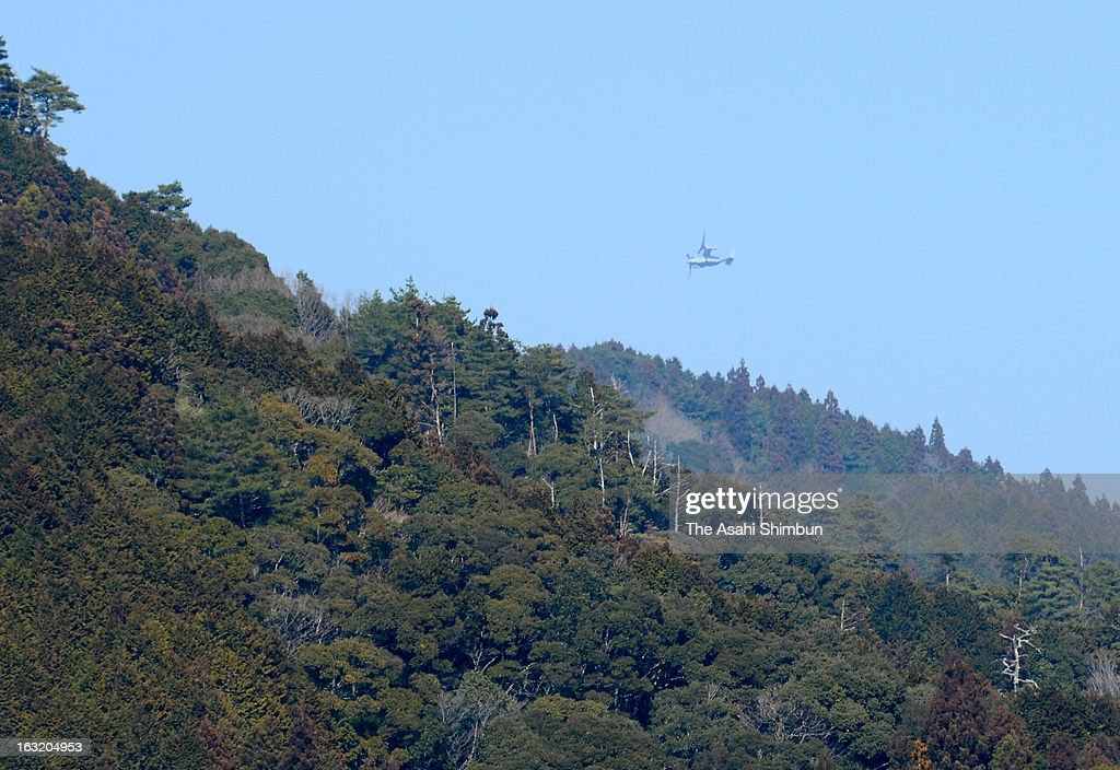 An U.S. Marine Corps MV-22 Osprey flies over mountains on March 6, 2013 in Motoyama, Kochi, Japan. U.S. operates the first exercise in Japan's main islands.