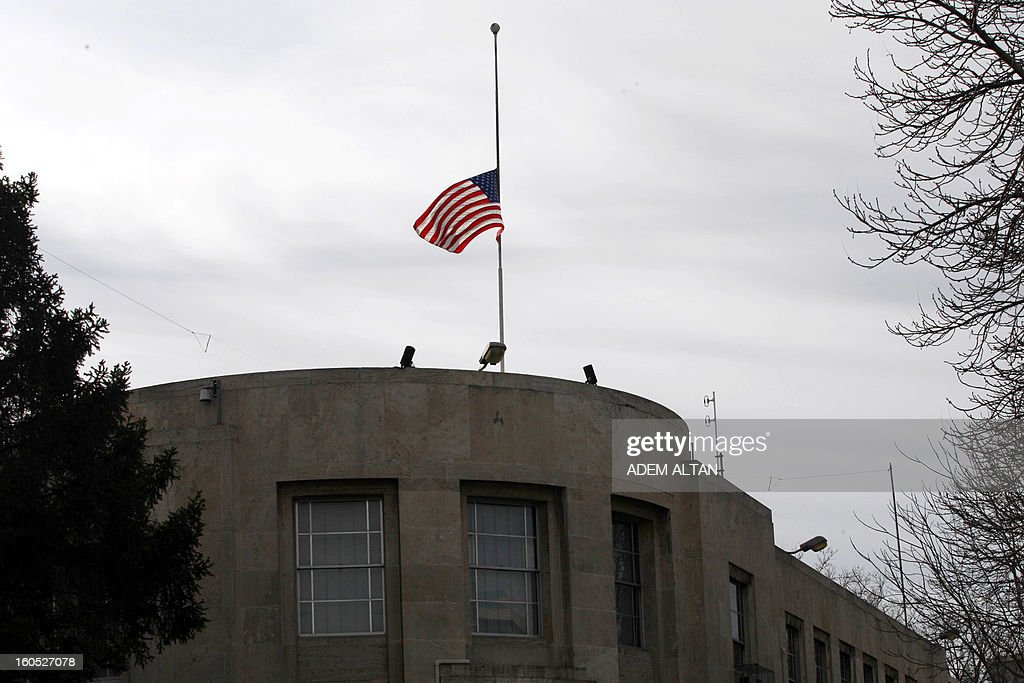 An U.S. national flag flies at half-staff above the US Embassy in Ankara, a day after a leftist suicide bomber in Ankara, on February 2, 2013. Two security guards were killed in the blast outside the US embassy, local television reported, amid speculation it was a suicide attack. The force of the explosion damaged nearby buildings in the Cankaya neighborhood where many other state institutions and embassies are also located.