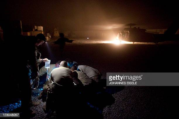 An US soldiers gets medical treatments before he gets into the Medevac of 159th Brigade Task Force Thunder to be airlifted to Kandahar Hospital Role...