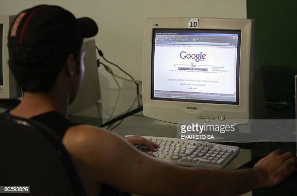 An user checks a Google website in a cybercafe in Brasilia on April 09 2008 A Brazilian Senate panel ordered Google on Wednesday to give it access to...