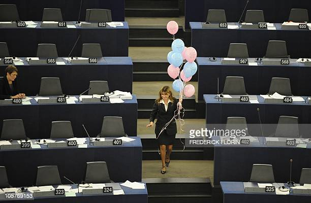 An usher collects balloons at the end of a vote on October 20 2010 at the European Parliament in the northeastern French city of Strasbourg in favor...