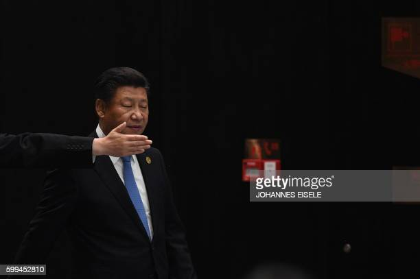 TOPSHOT An usher gestures as China's President Xi Jinping arrives to deliver his closing statement for the G20 Summit in Hangzhou on September 5 2016...
