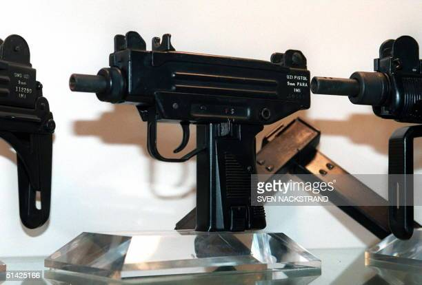 An Uzi pistol is displayed next to the larger Uzi submachine gun models at the Israeli Military Industries in Ramat Hasharon 11 November The IMI...