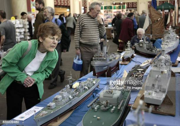 An visitor views model ships on display at the London Model Engineering Exhibition 2009 at Alexandra Palace London