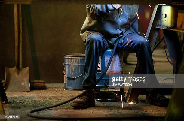 An welder at Specialty Fab in North Lima Ohio works on a piece of a compressor skid frame on March 1 which is bound for the Ohio Shale project Sparks...