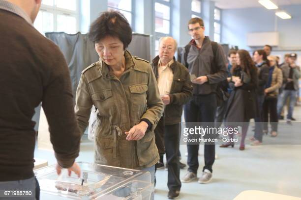 An woman votes in the first round of the Presidential race in the Belleville neighbourhood a mixed ethnic area in the 19th arrondissement on April 23...