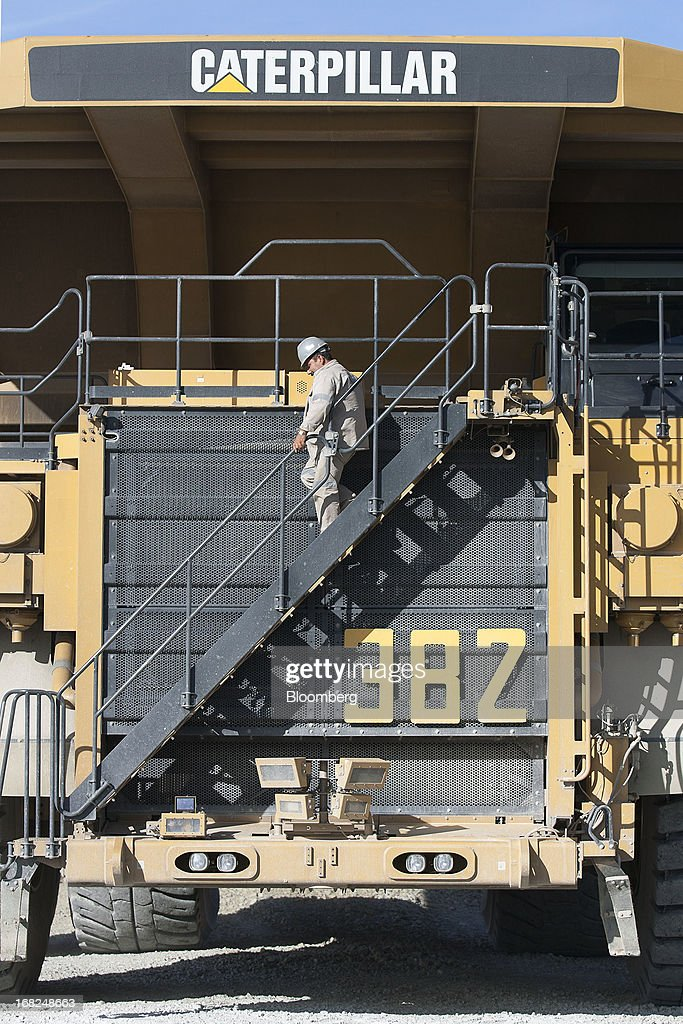 An worker descends the stairs or a Caterpillar Inc. truck at Grupo Mexico SAB's La Caridad open pit copper mine in Sonora, Mexico, on Monday, May 6, 2013. Grupo Mexico SAB, Mexico's biggest mining company by market value, estimates it will produce 840,000 tons of copper in 2013. Photographer: Susana Gonzalez/Bloomberg via Getty Images