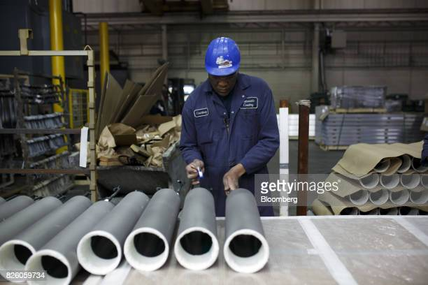 An worker handles sonar transducer tubes at the Automatic Coating Ltd facility in Toronto Ontario Canada on Wednesday Jan 11 2017 Statistics Canada...