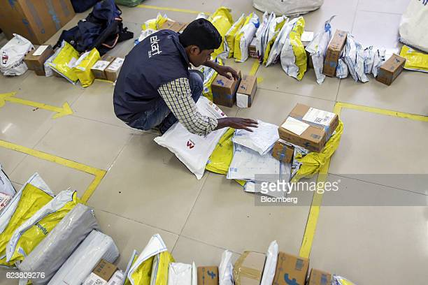 An worker sorts packages at a Flipkart Online Services Pvt office in the Jayaprakash Narayan Nagar area of Bengaluru India on Wednesday Oct 26 2016...