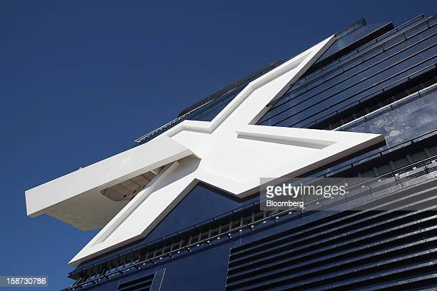 An 'X' logo which stands for the Greek letter chi is displayed on the smoke stack of Celebrity Cruises Inc's Constellation cruise ship in the...
