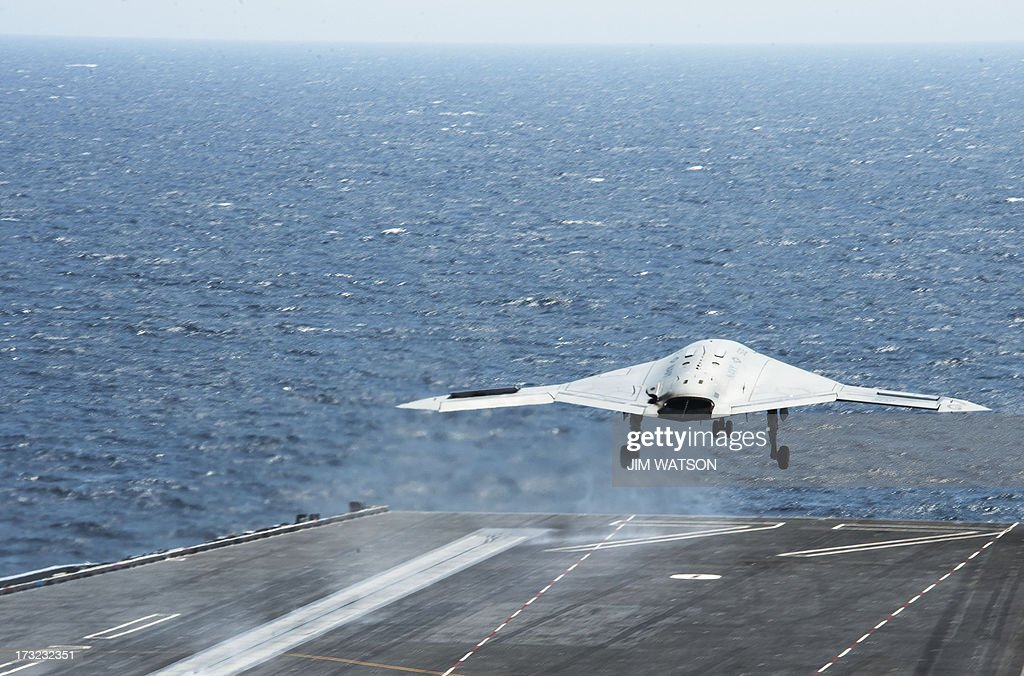 An X-47B Unmanned Combat Air System (UCAS) takes off from the catapult after making the very first carrier landing aboard the USS George H.W. Bush while afloat in the Atlantic Ocean off the coast from Norfolk, Virginia, on July 10, 2013.