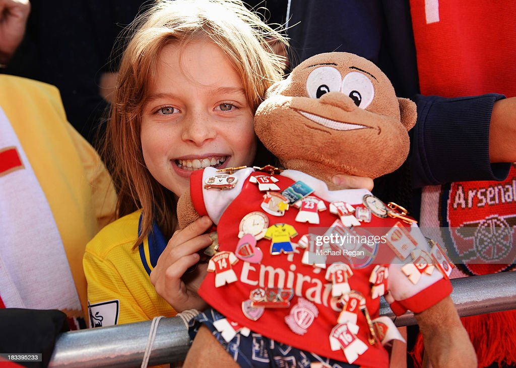 An young Arsenal fan and mascot enjoy the atmosphere prior to the Barclays Premier League match between West Bromwich Albion and Arsenal at The Hawthorns on October 6, 2013 in West Bromwich, England.