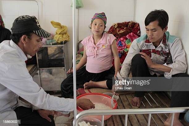 An young couple with husband father having simple meal for lunch They are waiting for baby dilivery in Bao Lam district hospital The World Health...