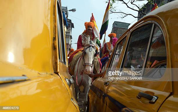 An young Indian Jain devotee dressed on a horse participates in a religious rally organised on the occasion of Mahavir Jayanti in Kolkata on April 2...