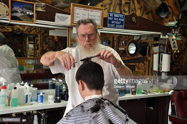 An young man gets a haircut at Ernie's Barbershop in Browns Mills New Jersey on July 29th 2014 The shop caters to many servicemen of nearby joint...