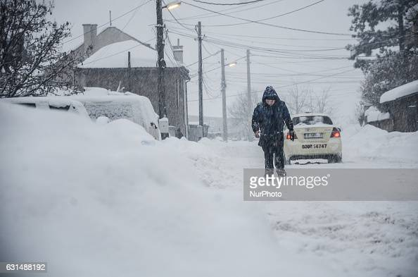 An young man is walking as snow falls at the streets of Svilengrad Bulgaria on January 11 2017 Snow paralyse Bulgaria The snow reached 40 70 sm at...