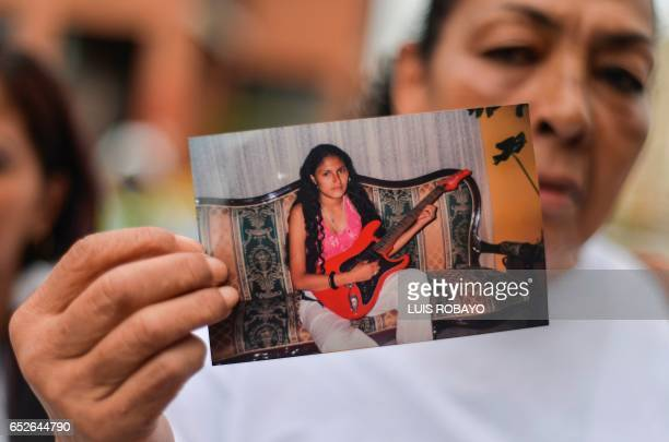 Ana Alzate mother of Leidy Johanna Barcenas Alzate who was arrested in China for drug trafficking holds a picture of her daughter during the funeral...