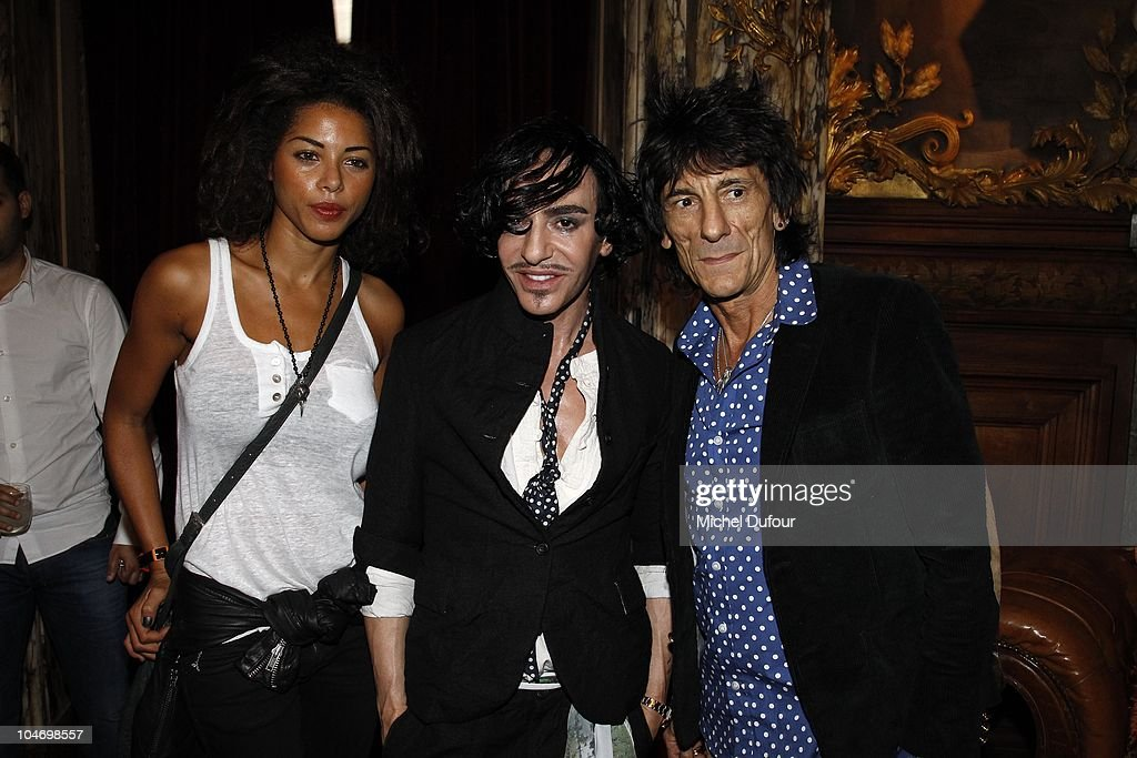 Ana Araujo, John Galliano and Ron Wood attend the John Galliano Ready to Wear Spring/Summer 2011 show during Paris Fashion Week at Opera Comique on October 3, 2010 in Paris, France.