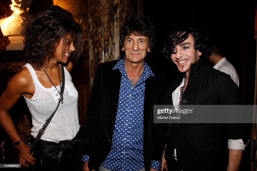 Ana Araujo, John Galliano and <a gi-track='captionPersonalityLinkClicked' href=/galleries/search?phrase=Ron+Wood+-+Musician&family=editorial&specificpeople=208076 ng-click='$event.stopPropagation()'>Ron Wood</a> attend the John Galliano Ready to Wear Spring/Summer 2011 show during Paris Fashion Week at Opera Comique on October 3, 2010 in Paris, France.
