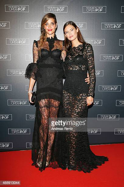 Ana Beatriz Barros and Bianca Balti attend Intimissimi on Ice OperaPop at the Arena di Verona on September 20 2014 in Verona Italy The world diverted...