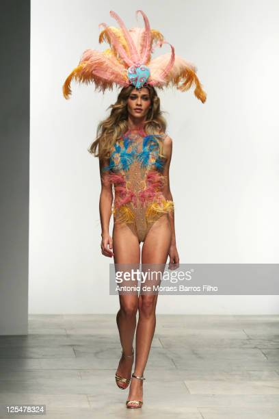 Ana Beatriz Barros walks the runway at the Issa London S/S 2012 show at London Fashion Week at Natural History Museum on September 17 2011 in London...
