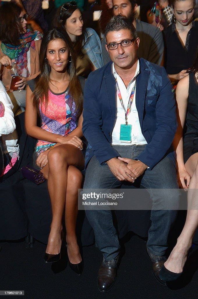 <a gi-track='captionPersonalityLinkClicked' href=/galleries/search?phrase=Ana+Boyer&family=editorial&specificpeople=4043272 ng-click='$event.stopPropagation()'>Ana Boyer</a> (L) attends the Desigual Spring 2014 fashion show during Mercedes-Benz Fashion Week at The Theatre at Lincoln Center on September 5, 2013 in New York City.