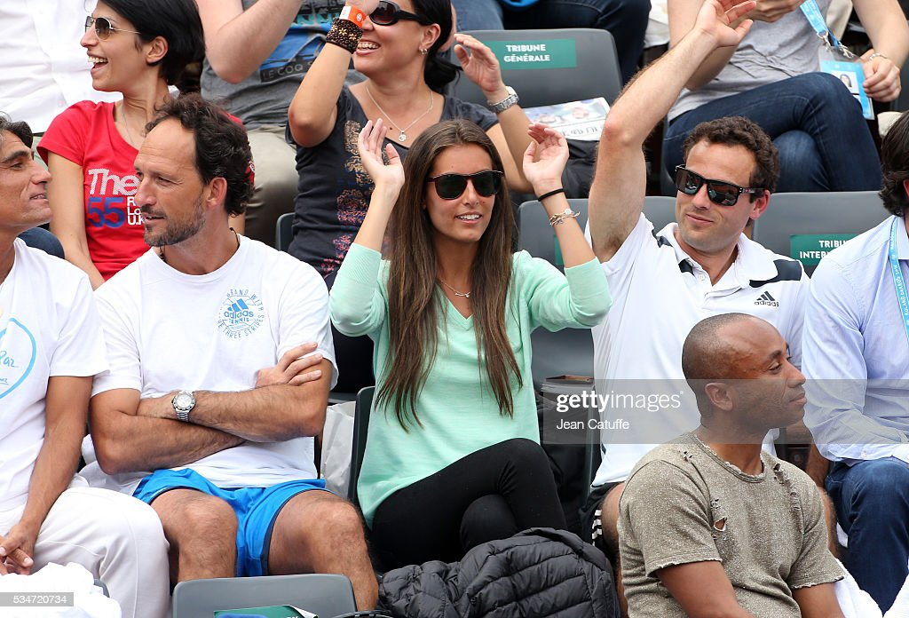 Ana Boyer Preysler, girlfriend of Fernando Verdasco and his coach David Sanchez (left) support him during his match against Kei Nishikori of Japan on day 6 of the 2016 French Open held at Roland-Garros stadium on May 27, 2016 in Paris, France.