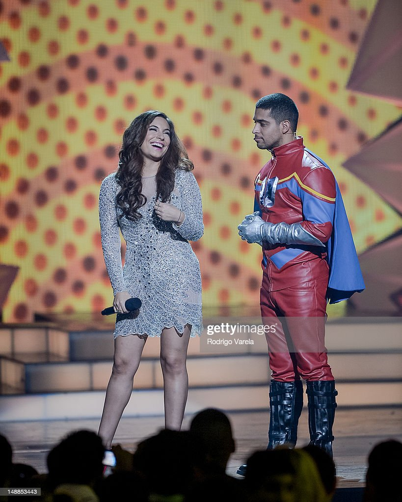 Ana Brenda and <a gi-track='captionPersonalityLinkClicked' href=/galleries/search?phrase=Wilmer+Valderrama&family=editorial&specificpeople=202028 ng-click='$event.stopPropagation()'>Wilmer Valderrama</a> onstage during the Univision's Premios Juventud Awards at Bank United Center on July 19, 2012 in Miami, Florida.