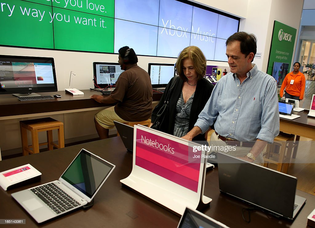 Ana Bustamante (L) and Bill Bustamante look at a computer loaded with the new Windows 8.1 operating system at a Microsoft store in the Dadeland Mall October 17, 2013 in Miami, Florida. The update was released a year after Windows 8 was released and includes fixes to some of the problems people experienced with the initial release.