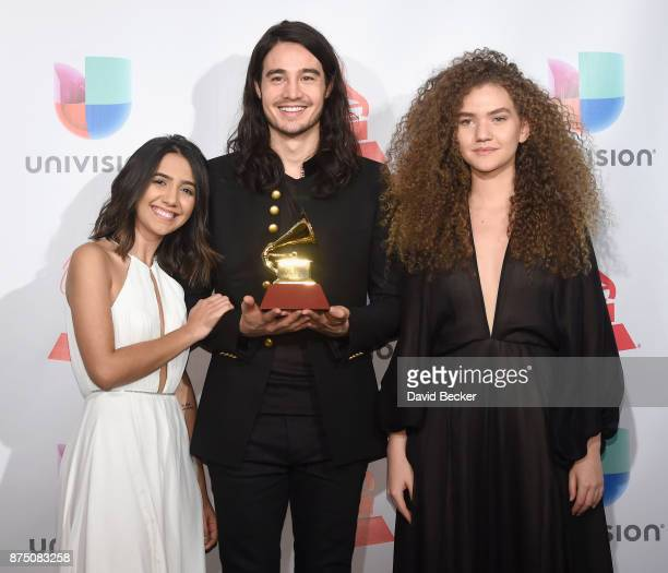 Ana Clara Caetano Tiago Iorc and Vitoria Falcao pose in the press room during The 18th Annual Latin Grammy Awards at MGM Grand Garden Arena on...