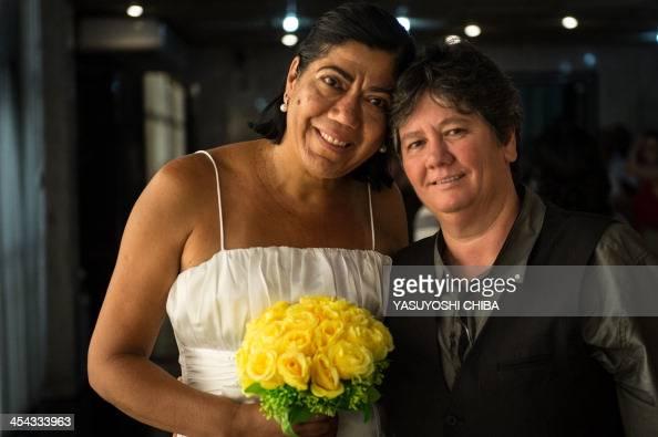 Ana Cristina Ribero Martins and Claudia Almeida Martins pose after the wedding ceremony at the Court of Justice of the State of Rio de Janeiro in Rio...