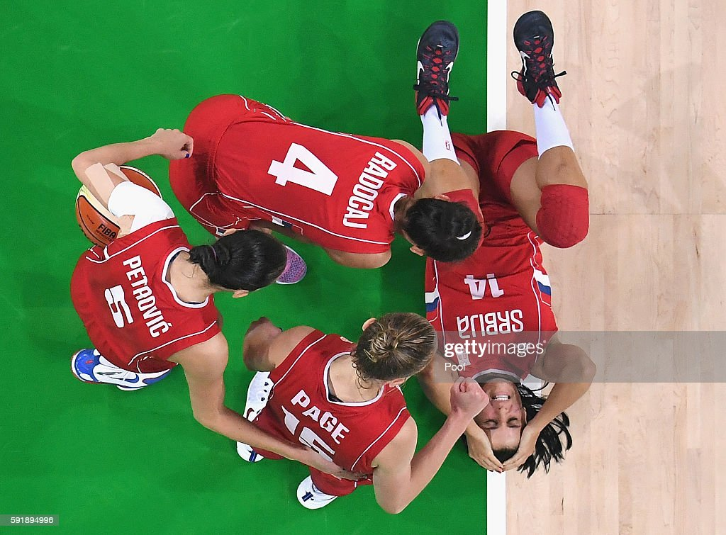 Ana Dabovic of Serbia reacts after falling down during the second half in the Women's Semifinal game against Spain on Day 13 of the Rio 2016 Olympic...