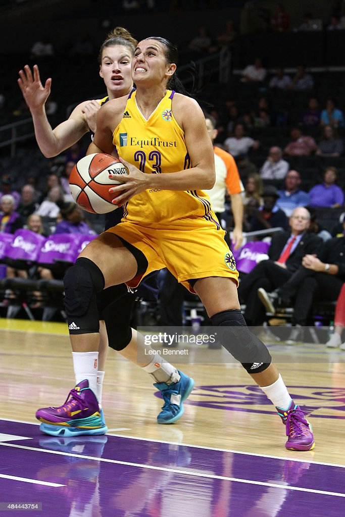 Ana Dabovic #23 of the Los Angeles Sparks handles the ball against <a gi-track='captionPersonalityLinkClicked' href=/galleries/search?phrase=Maggie+Lucas&family=editorial&specificpeople=7449966 ng-click='$event.stopPropagation()'>Maggie Lucas</a> #8 of the Indiana Fever in a WNBA game at Staples Center on August 18, 2015 in Los Angeles, California.