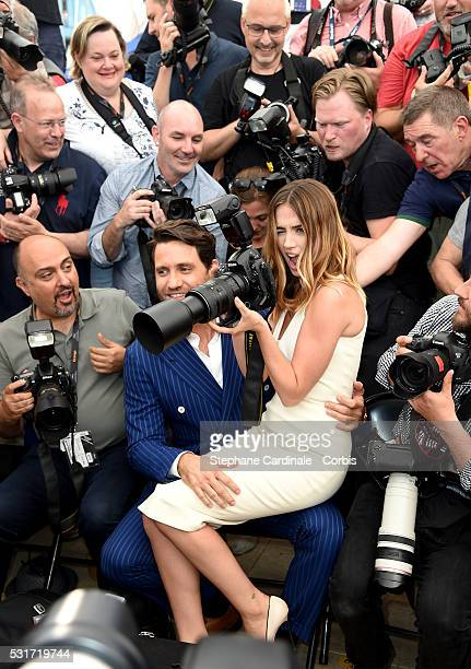 Ana de Armas uses a photographer's camera as Edgar Ramirez looks on during the 'Hands Of Stone' photocall during the 69th annual Cannes Film Festival...